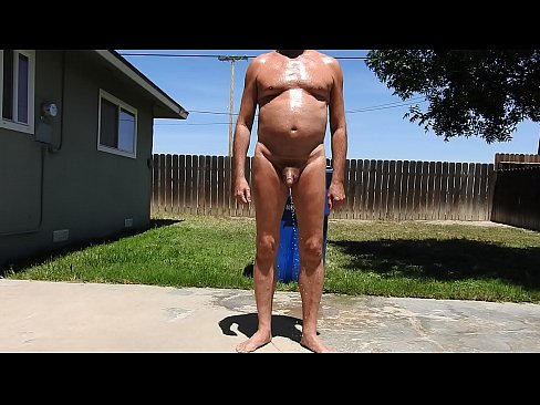 A Mature Naked Man Peeing In Circles.